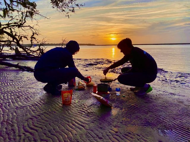 Lewis and Charles cooking dinner at sunset, Brickhill Bluff, Cumberland Island, January 2020.  This photo so brilliantly captures the essence of Scouting!